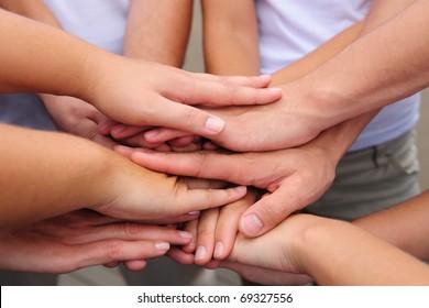 teamwork, group putting hands together