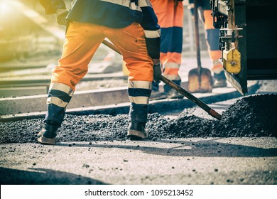 Teamwork, Group of workers on a road construction, team of people at work