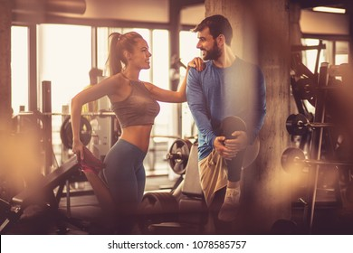 Teamwork in gym. Couple working exercise together.