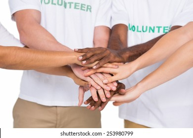 Teamwork with hands together standing on white background