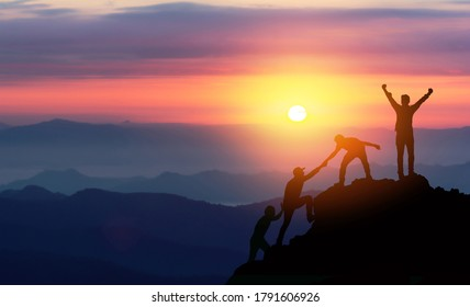 Teamwork helping hand trust assistance silhouette in mountains, sunset. Team of climbers man hiker, help each other on top of mountain, Business concept. - Shutterstock ID 1791606926
