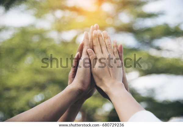 Teamwork high five as team together hands air greeting  power tag team. Group of diversity people multiethnic  unity togetherness in Volunteer community. Collaboration Business Team success concept.