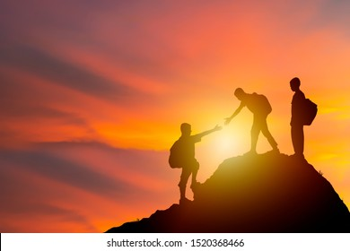 Teamwork isolate concept. Climbing carrying a backpack too adventure, a new challenge. I am reaching out to look at that draws more people to the summit as well. He has assisted as well.