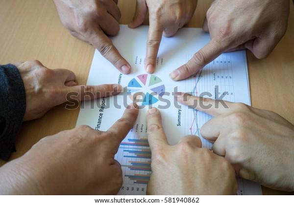 Teamwork Join finger Support Together Concept on finance report