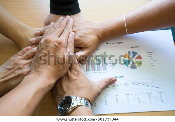 Teamwork Join Hands Support Together Concept on finance report