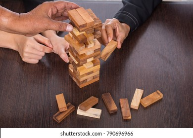Teamwork join to stack wood for success to all in one team.