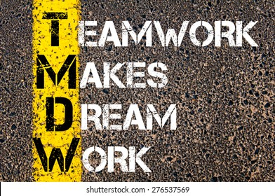 Teamwork makes dream work motivational quote. Yellow paint line on the road against asphalt background. Concept image