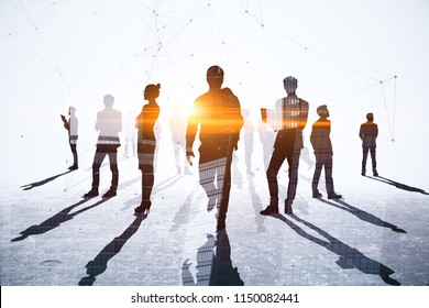 Teamwork, meeting and network concept. Businesspeople crowd silhouettes on light city office background. Double exposure