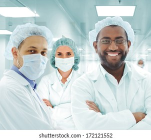 Teamwork at modern hospital lab, group of doctors