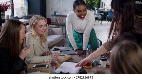 Teamwork at modern office meeting, beautiful young black business woman leading creative team discussion slow motion.