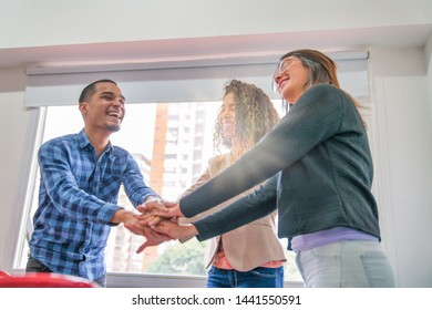 Teamwork in the office. Three people happy for success.
