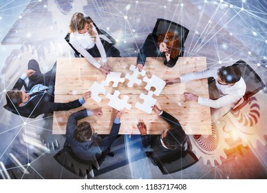 Teamwork of partners. Concept of integration and startup with puzzle pieces and gear overlay. double exposure with network effects