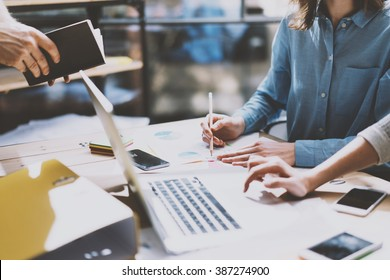 Teamwork. Photo young businessmans crew working with new startup project. Generic design notebook on wood table.  Analyze plans, pencil hands, keyboard. Blurred background, film effect
