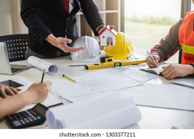 Teamwork process, Engineer and businessman meeting and planning construction project together.