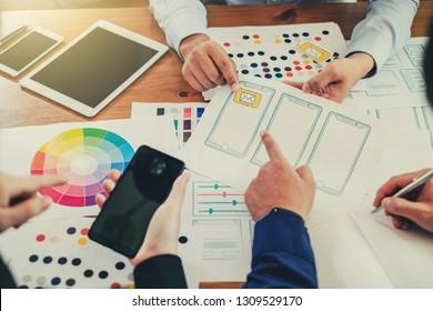 Teamwork process, Graphic designer creative planning work together on website ux ui app development.