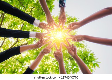 Teamwork putting their hands together,business team with stack of them hands showing unity,join hands partnership concept.