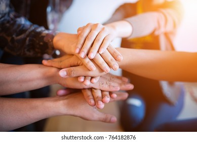 Teamwork putting their hands together,join hands partnership and teamwork concept.