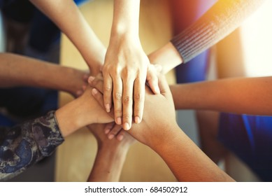 Teamwork  putting their hands together,teamwork with stack of them hands showing unity,join hands partnership concept.