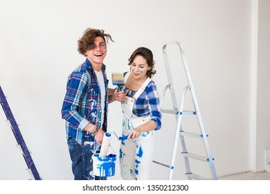 Teamwork and redecoration concept - young couple doing a renovation in new apartment