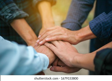 teamwork stacking hand concept,people show symbolic hand for promised purpose to achieve the goal.