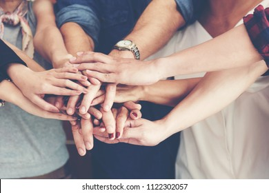 Teamwork Success.  Top view executive business people group team happy showing teamwork and joining hands or giving five for harmony after meeting partner business in office. Business  Concept.