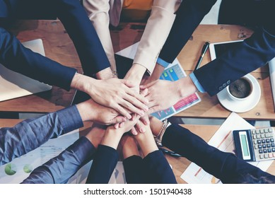 Teamwork Success.  Top view executive business people group team happy showing teamwork and joining people hands after meeting partner business in office. Business  Concept., select focus