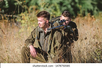 Teamwork and support. Activity for real men concept. Hunters with rifles in nature environment. Hunters gamekeepers looking for animal or bird. Hunting with friends. Hunters friends enjoy leisure.