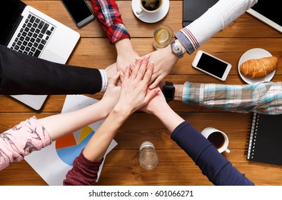 Teamwork, team connect hands togetherness concept, show connection and alliance. Teambuilding in the office, young businessmen and women in casual unite hands for teamwork and cooperation