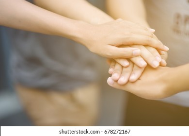Teamwork togetherness collaboration, business teamwork concept. Concept of teamwork, Close-Up of hands business team showing unity with putting their hands together. Selective focus.