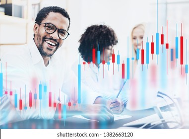 Teamwork traiding concept.African american man in white shirt smiling at the camera. Red and green candlestick chart and stock trading computer screen background. Double exposure