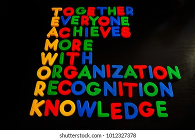 TEAMWORK word cloud with colorful plastic letters on black background , business concept