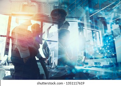 Teamwork works with a computer. Concept of internet sharing and interconnection. double exposure.