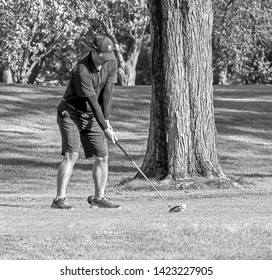 TEANECK, NEW JERSEY - JUNE 11, 2017: A golfer preparing to tee off on one of Bergen County Parks Department's golf courses, Overpeck Golf Course. Overpeck is an 18 hole public golf course.