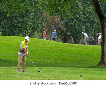 TEANECK, NEW JERSEY - JUNE 16, 2019: A golfer preparing to tee off on one of Bergen County Parks Department's golf courses, Overpeck Golf Course. Overpeck is an 18 hole public golf course.
