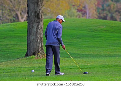 TEANECK, NEW JERSEY - OCTOBER 12, 2019: A golfer preparing to tee off on one of Bergen County Parks Department's golf courses, Overpeck Golf Course. Overpeck is an 18 hole public golf course.