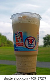 TEANECK, NEW JERSEY/USA - AUGUST 27, 2017: A large size Dunkin' Donuts Frozen Dunkin' Coffee. The Frozen Coffee replaced their Coffee Coolatta, which has been discontinued.