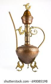 Teapot brass teapot on a white background.