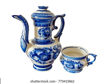 Teapot and cup on a white background. Things in Russian traditional Gzhel style. Closeup. Gzhel - Russian folk craft of ceramics and production porcelain and a kind of Russian folk painting.