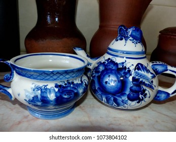 Teapot and cup with saucer. Things in Russian traditional Gzhel style. Closeup. Gzhel - Russian folk craft of ceramics and production porcelain and a kind of Russian folk painting.