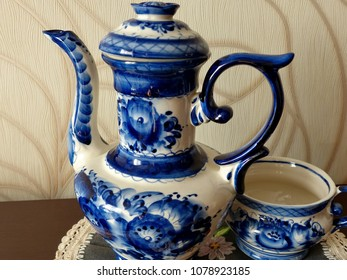 Teapot and cup. Things in Russian traditional Gzhel style. Closeup. Gzhel - Russian folk craft of ceramics and production porcelain and a kind of Russian folk painting.