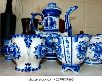 Teapot and cups. Cooking battery. Things in Russian traditional Gzhel style. Closeup. Gzhel - Russian folk craft of ceramics and production porcelain and a kind of Russian folk painting.