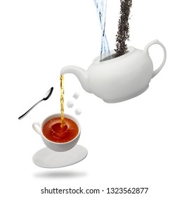 teapot pours in a cup of tea spoon refined saucer isolated on white background