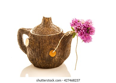 Teapot and red clover flowers  isolated on white background