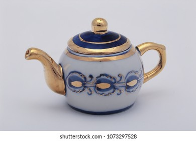 Teapot in Russian traditional Gzhel style. Closeup. Gzhel - Russian folk craft of ceramics and production porcelain and a kind of Russian folk painting. Selective focus.