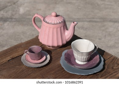Teapot with teacup  ceramic on wood background.