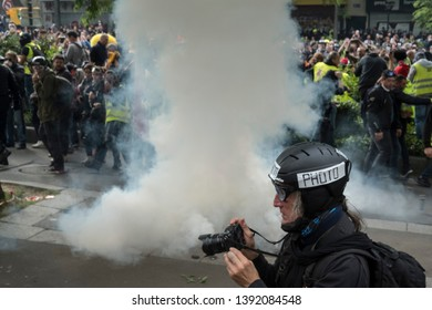 Tear gas explodes next to a photographer during the May Day protests in Paris, France. 01/05/19