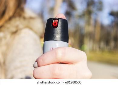 Tear gas spray in female hand. Means of self-defense. Pepper spray