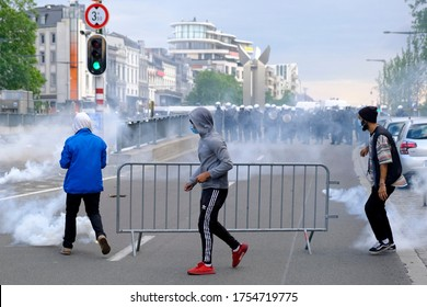 Tear gas thrown by riot police to disperse protesters during the Black Lives Matter protest rally, in Brussels, Belgium on Sunday, June 7, 2020.