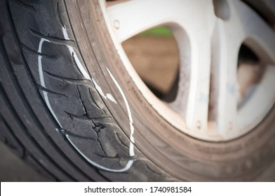 Tear marks on bald tires, car use unsafe tyre dangerous for vehicle.