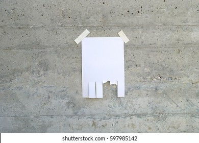 tear off paper on light grey concrete wall